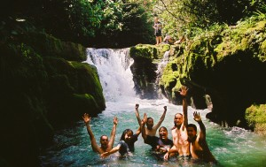 Swimming in a jungle waterfall