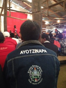 Visiting family members of the 43 disappeared from Ayotzinapa listens to a Zapatista woman in the auditorium at Oventic, Chiapas, Mexico.