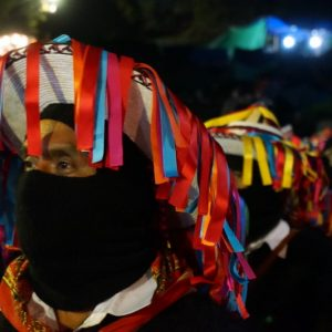 Wearing traditional Tzotzil hats and carrying poles of power, Zapatista authorities listen intently to presentations by the families of the the 43 disappeared student-teachers from Ayotzinapa on Jan. 31, 2014.